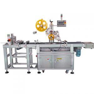 Marķēšanas mašīna ar padeves un savākšanas ierīci